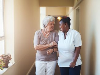 A carer taking care of an elderly client